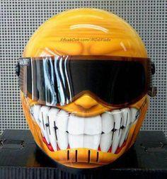 Don't worry, be happy! Smile, teeth and all, orange helmet with dark visor.