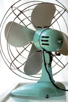 Aqua vintage metal fan - The Jane Studio on Etsy  Love fans and an open windows. Only AC when it is mega hot.