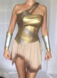 Payment plan accepted. Please message me. THIS WONDER WOMAN COSTUME WILL BE TAILORED TO YOUR MEASUREMENTS: PLEASE RESPOND THE FOLLOWING QUESTIONS:  1) I would need your following measurements: bust(the fullest part with the bra on) bra size below the bust waist(the narrowest part of the torso) hips(the widest part) wrist(measure just above the bone) how tall are you? When taking these measurements, use a cloth tape measure, not a metal one. Make sure that, when you circle your chest, waist…