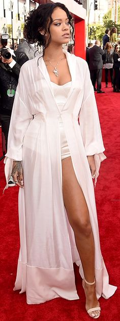 I don't care if it does look like a bathrobe, Rihanna is rocking the FOOL out of this look!