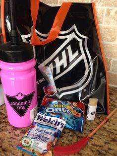 """NHL birthday party loot bag - Hockey water bottle, homemade chapstick, Oreos """"hockey pucks"""", fruit snacks and pencil hockey stick. Pink bottles for then girls and white for the boys."""
