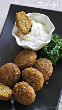 GLUTEN FREE BAKED FALAFEL ~ Falafel is a traditional Middle-Eastern dish, made with ground chickpeas or fava beans usually deep fried and served in a pita. This is a baked version, making it a healthier option that I like to serve as an appetizer with a yogurt or top it with eggplant dip.