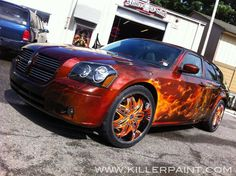 """2005 Dodge Magnum - """"Cats Roar"""" - Auctioned off with 50% of the proceeds going to Big Cat Rescue - Airbrushed by Mike Lavallee of Killer Paint - www.killerpaint.com."""