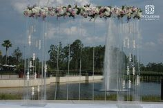 Modern wedding altar with fresh floral border and floating candles by #OBSevents