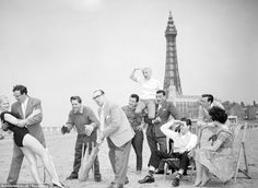 Eric Morecambe, Ernie Wise, Jimmy James, The Trio Vedette, David Galbraith, Bretton Woods and Shelley Marshall posing on the sands in 1959 i...