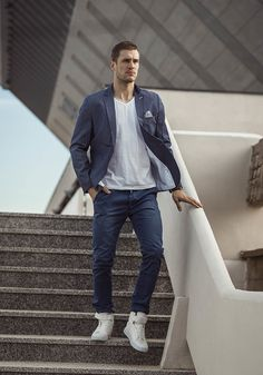 Modern and minimalistic outfit from Bolf in urban style. Navy blue chinos are set with a light blazer. The set is completed with a white V-neck T-shirt and fantastic sneakers. Comfortable and stylish.