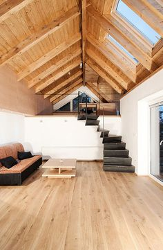 Wooden tall interior with black metal design staircases.