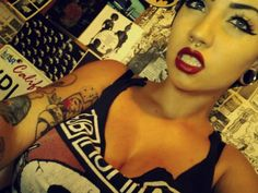 Pinup make up, tattoos, and piercings....yes.