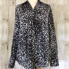 """Lane Bryant Animal Print Top A gorgeous black and white and shades of grey animal print top by Lane Bryant in excellent condition.  Button front with cuffed long sleeves. 96% cotton/ 4% spandex. Curved shirttail bottom.  About 27"""" from base of collar to hem at the longest point. Lane Bryant Tops Blouses"""