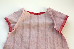 This free infant peasant dress pattern is perfect for any baby girl and is easy and quick to make! Make a handful of darling dresses in no time!