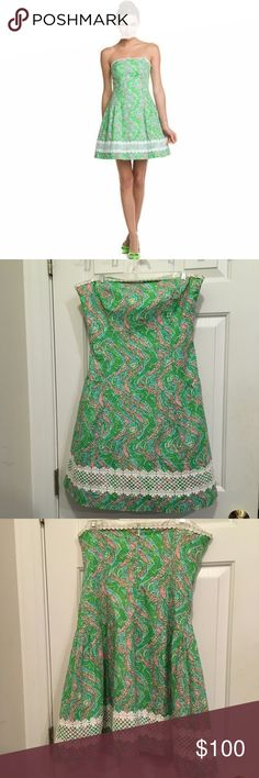"""Size 10 Lilly Pulitzer Jordan Dress Gorgeous size 10 Lilly Pulitzer Jordan style dress in chomp chomp print in shorely blue! The only flaw is that the hanging tags for hanging on hangers has been cut out, no rips, stains, flaws.  The Jordan's drop-waist and full skirt are as flattering as they come. Made of printed cotton poplin and featuring a custom Lilly lace trim. There's a hidden back zipper and boning in the bodice. A beautiful dress for many occasions!  Measurements: B-17"""", W-16""""…"""