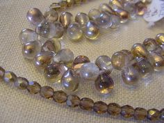Destash Beads 50 Champagne Topaz briolette beads 6x9mm and 50 - 4mm smoky topaz ab round faceted beads Destash briolette beads by Magicclosetbling on Etsy