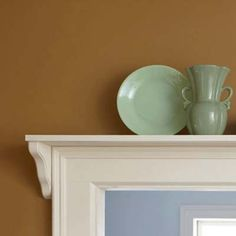 Add a shelf above a doorway, paint it to match the trim, then use it to display pottery. | Photo: Beth Singer | thisoldhouse.com