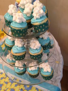 cloud cupcakes for rain and duck themed baby shower