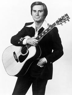 """George Jones: One of the most famous of country singers died at 80, 2013. Even though country music is not my preference  I remember growing up with a steady diet of it with my mom. I can still hear his classic country voice, """"He stopped loving her today""""."""