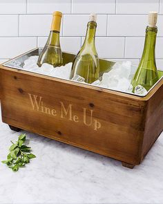 This personalized wooden wine trough is the perfect wedding gift for any couple who loves to entertain. Rustic in style, this wine cooler is made of fir wood and features a removable, metal ice bucket to keep beverage chilled.