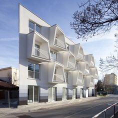 This social housing block in Slovakia by Bratislava studio Nice Architects features a series of protruding balconies that angle towards sunlight.