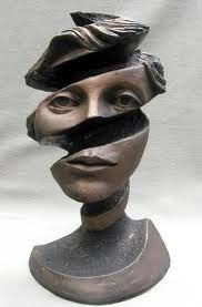 Screwed up twisted female face sculpture