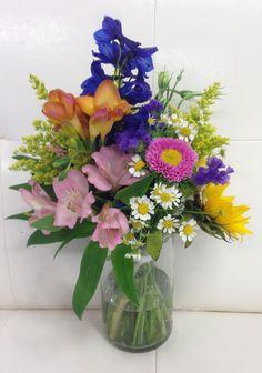 Spring bouquet. Sunflower, delphinium, tuberose, solidago, alstromeria, statice, monte casino.  Adorna Design at TerrAdorna.