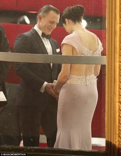 For his eyes only: Daniel Craig looked ecstatic to see Rachel after greeting the crowd and having his fair share of photographs taken