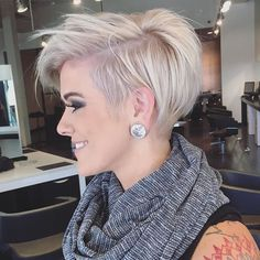 Short asymmetrical blonde cut.
