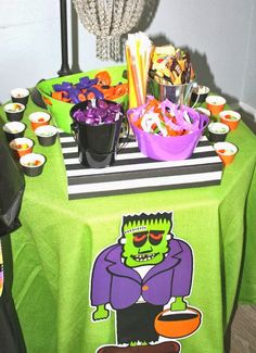 Trick or Treat station at a Halloween Party! Stock it with lots of fun Halloween toys and glow sticks!
