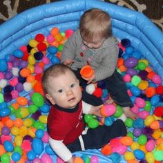 Seeking out new ways to engage my 10-month-old daughter's senses, I decided to fill our little inflatable pool with plastic eggs (big and small) and a bunch of giant 2-inch pom-poms (so I would see if they tried to eat them). She and her cousin had a blast!