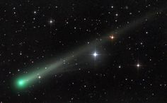 Two new tail streamers are visible between Comet ISON's green coma and bright star near center. in this photo taken on Nov. 6. Credit: Damian Peach.