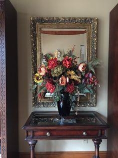 Flower arrangement between the bookcases in the great room
