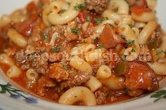 Southern Beef and Sausage Goulash - An American goulash, made with ground beef, Italian sausage and andouille, tomato, garlic and pasta, and seasoned with the Trinity and a bit of Cajun seasoning.   Read Recipe by birnercm