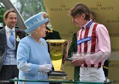 Queen Elizabeth II smiles as she presents Diamond Jubilee Stakes trophy to jockey Adam Kirby after he won riding Lethal Force during day five of Royal Ascot at Ascot Racecourse on June 22, 2013 in Ascot, England.  (Photo by Kirstin Sinclair/Getty Images for Ascot Racecourse)