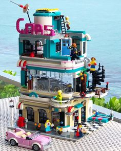 The LEGO Creator Downtown Diner has been out for a few weeks now and fans have already taken liberty to modify their sets into their own including who has changed the Diner into a Downtown Cars showroom. Construction Lego, Amazing Lego Creations, Lego Blocks, All Lego, Lego Modular, Lego Design, Design Design, Lego Worlds, Lego Creator
