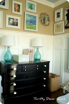 Love this room make over. LOVE the pics above the board and batten! via @ThriftyDecor