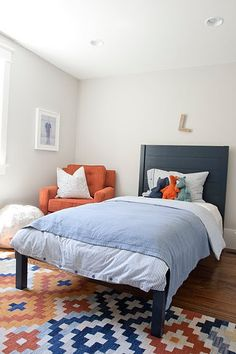 ***Navy and orange, and light gray walls. Nice and simple. Great colors together.