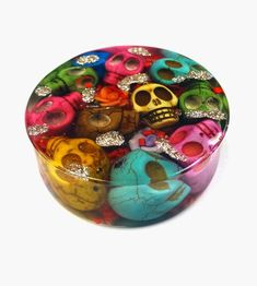 Resin paperweight. odd shaped beads, fuses and other tiny electric parts, game pieces