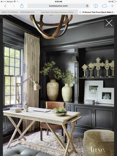 Office desk with black walls