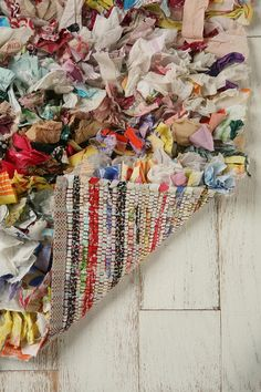 Crafting inspiration - Rag Rug - would this work on latch hook fabric?  Would you do a pattern, stripes or just random.  I like the idea.  Perhaps a craft for Jordon?