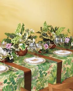 """Interesting putting a """"runner"""" at each place setting.  Certainly not this fabric, but I like the idea"""