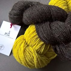 Help. Comments welcome on this colour combo. This is a future project probably a crocheted shawl of my own design. I definitely want to use my @knittingtastic skein (the lush brown one) but want a strong colour to go up against it. Do I go with this greeny yellow or should I try and find something in an electric blue? #ldjcrochethookup future project.