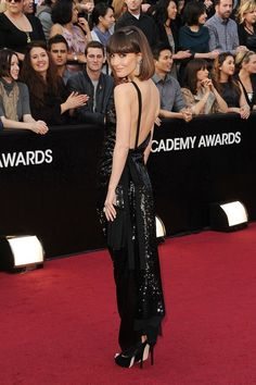 2012 – Rose Byrne in a Vivienne Westwood black sequin gown, Jimmy Choo heels and Chanel Fine Jewellery.