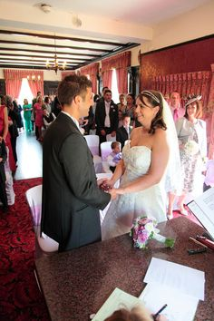 An indoor wedding ceremony at Bickley Manor