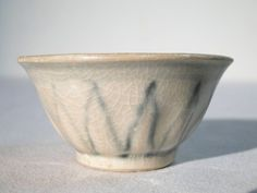 Very Fine Ancient Celadon Ceramic Bowl. Vietnam, circa 1500. Pale celadon glaze. Hand potted clay in bowl. Height 3.4 cm - Diameter 6.9 cm - 52 g. Provenance: Excavated by native people from old village site in Makassar, Sulawesi. Private collection of Rick Bennet.