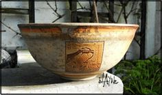 Wood fired ceramic bowl with laser decals. Terra sig. and sulphates. 1250deg. Blayne.