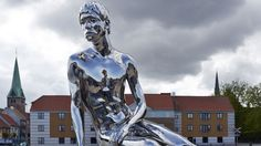 """The famous danish statue """"The Little Mermaid"""" from H.C.Andersen's fairytale, has a male counterpart located in Elsinore.   """"Han"""" is made of a polished stainless steel sculpture featuring a young boy on a stone."""