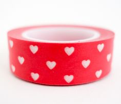 Single roll of red washi tape with mini white hearts. Great for scrapbooking, gift wrapping, decorating cards and envelopes and more! Add a little dash of cuteness to any crafting project! Washi tape