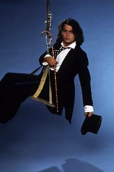 That same time he was on a swing with a cane and a top hat | Johnny Depp's Awesomely Bizarre PhotoPast