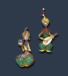 "AN AMUSING PAIR OF GEM-SET ""RAJAH"" BROOCHES, BY VAN CLEEF & ARPELS"