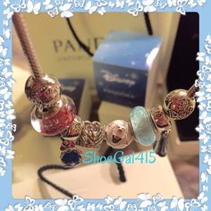 Authentic Pandora Disney Frozen Set of 6 Charms Included in this are the following 6 Frozen Charms: -Anna dress - $65 -Anna Murano -$50 -Elsa dress - $65 -Elsa Murano -$50 -Let it Go Heart - $40 -Anna Crown - $70 Original Retail Price =$340+ tax  Will sell separately and include a charm box if you purchase 2 or more charms.  All my Pandora items are purchased via an authorized retailer and are 100% guaranteed authentic. If you're searching for something in Disney Pandora please let me know…