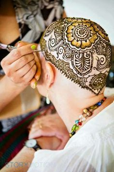Heena Crown is a form of body art. Usually, patients who have undergone chemotherapy and have lost all their hair, get it done