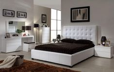 White athens contemporary clean lines bedroom with storage space bed. This modern five pieces white Italian design bed set will surely accentuate any contemporary bedroom! Bed has a luxury style with a tufted headboard and a storage underneath for your linen and bedding or just anything you might li...